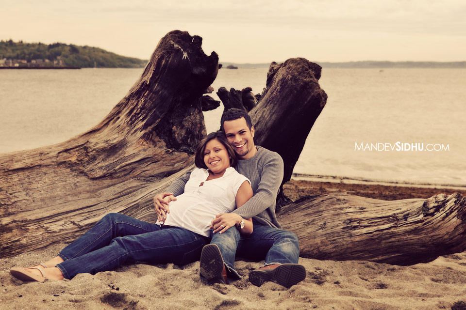 Maternity Photo of couple sitting on beach