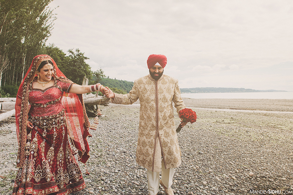 Portrait of Seattle Sikh wedding bride and groom standing on beach