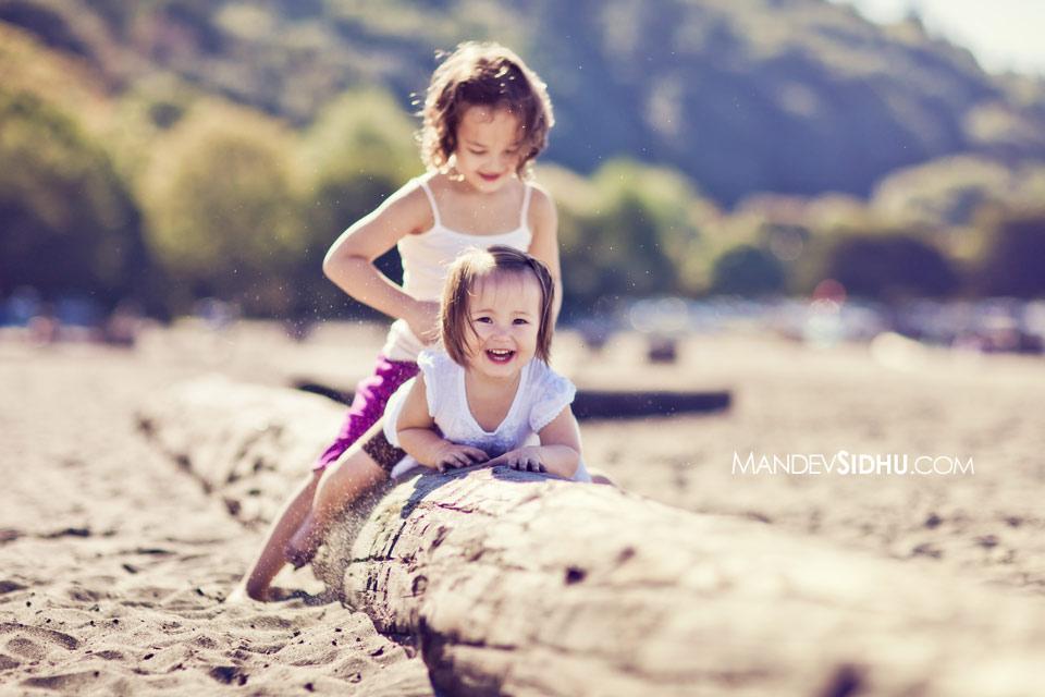 Girls playing on log