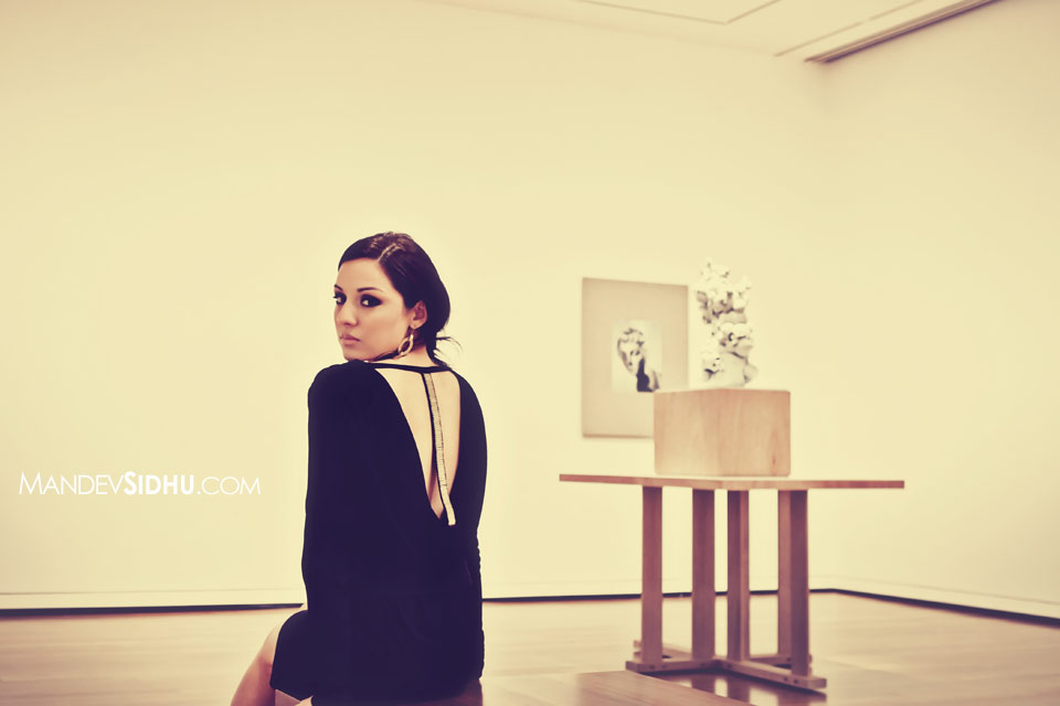 Beautiful model looks back at camera in Seattle Art Museum