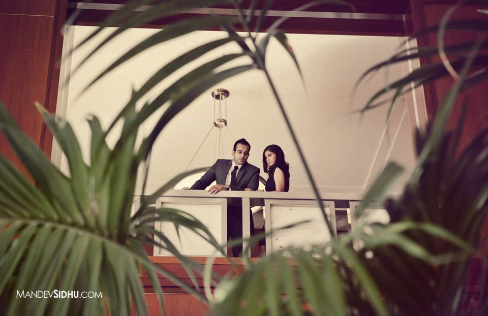 Corporate couple poses in downtown buidling