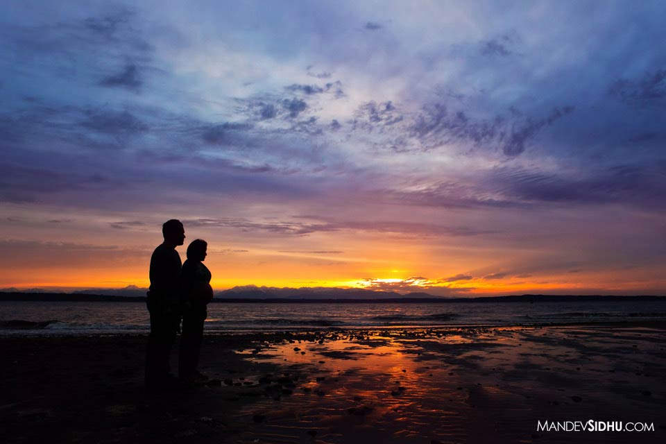 Maternity photograph on the beach with sunset