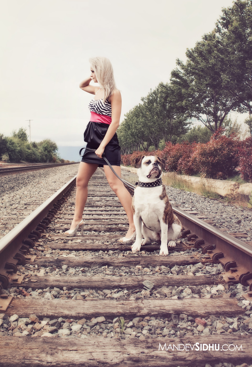 Brittany standing on railroad tracks in Bellingham, wa