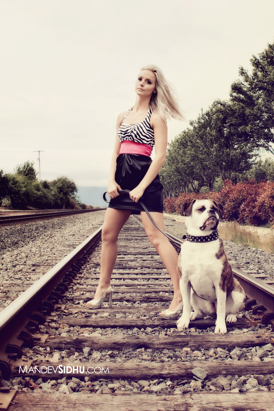 Beautiful professional portrait of Brittany standing on the railroad tracks in Downtown Bellingham