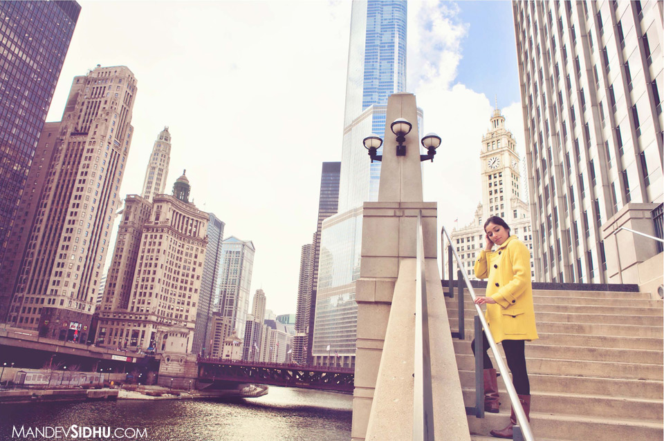 Model Standing on side of Chicago River with city skyline in background