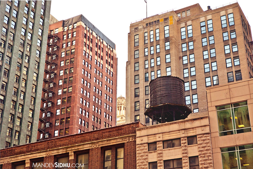 old water tower on top of building in downtown Chicago