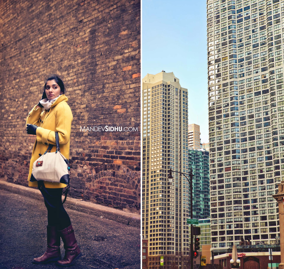 model wearing yellow jacket standing in a brick alley