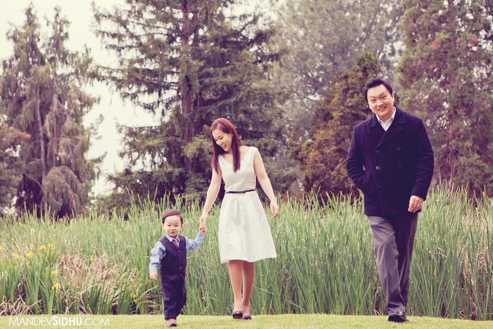 family photography walking through park