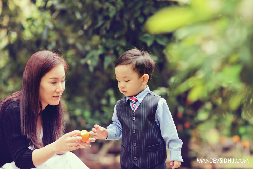 mother and son in orange orchard