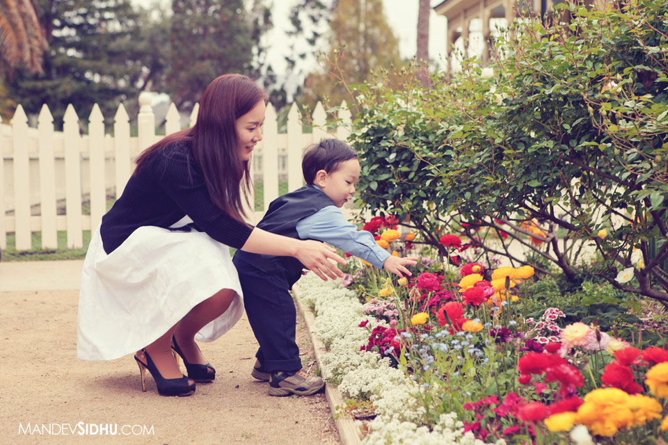 mother and son smelling flowers