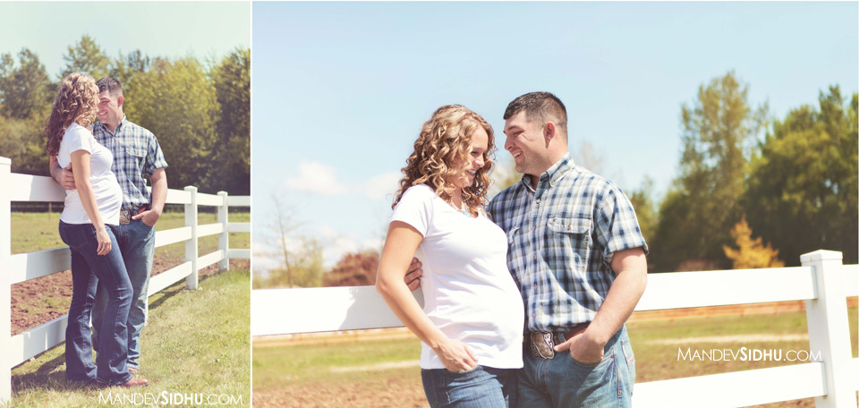 country-style maternity photo with white fence and field