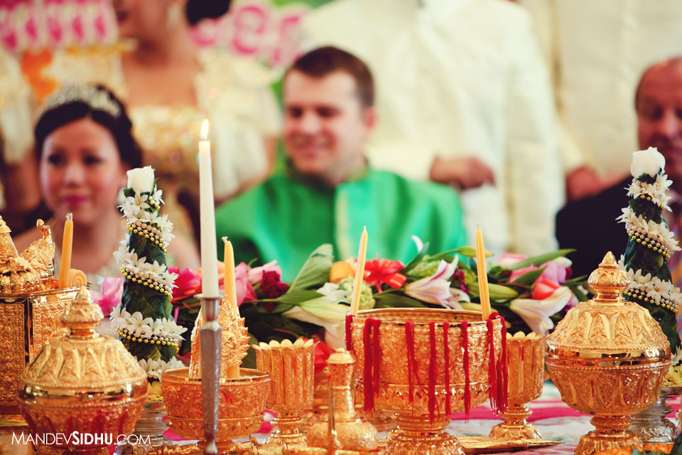 gold cups and red string traditional khmer ceremony table setting