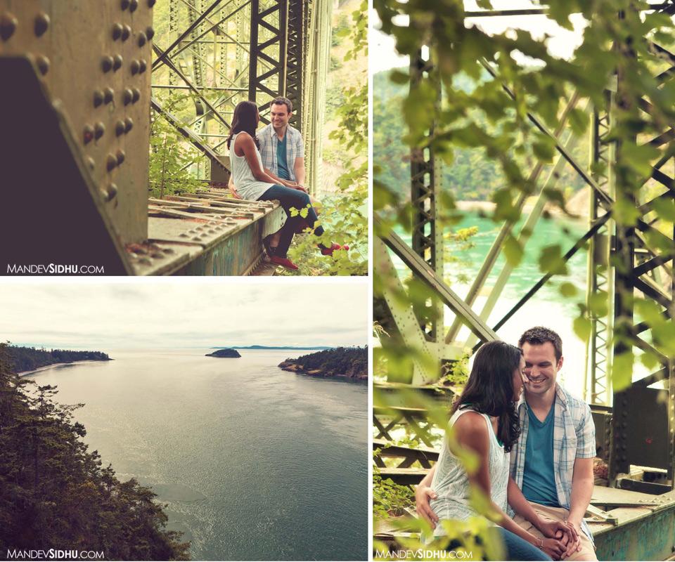couple sits underneath Deception Pass bridge