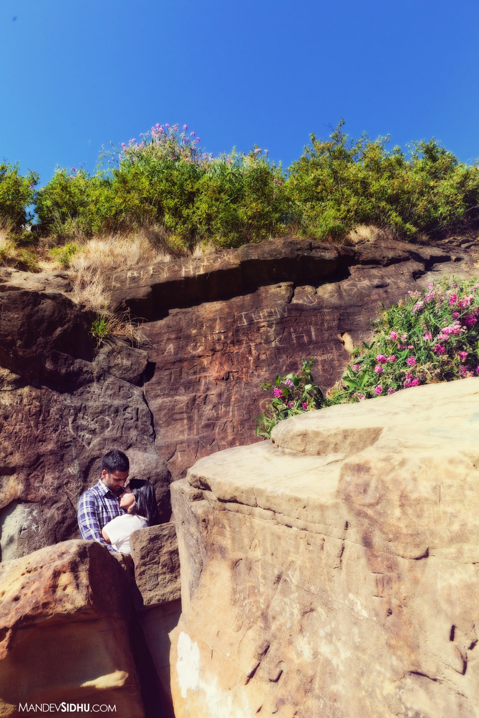 loving couple hugging each other near a cliff