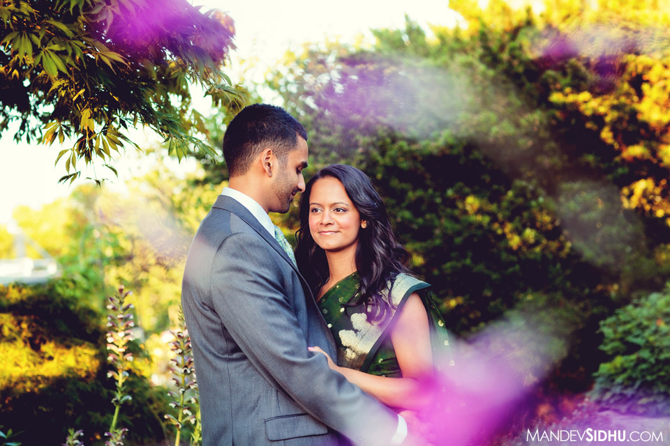 engagement photo sari, suit, in the park with pink flowers