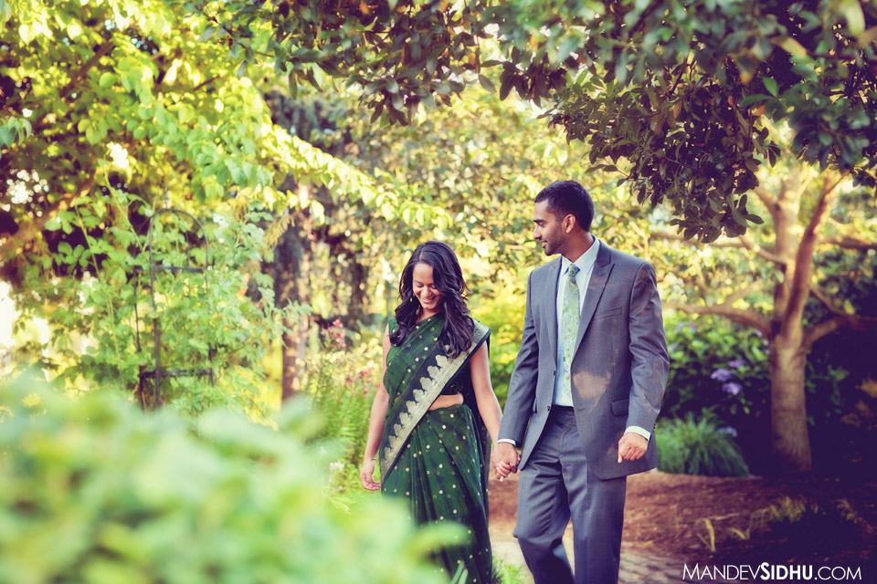 loving indian couple walking through park for engagement photos