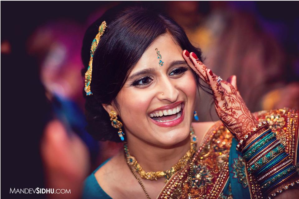 Happy Indian Bride wearing blue Lehenga