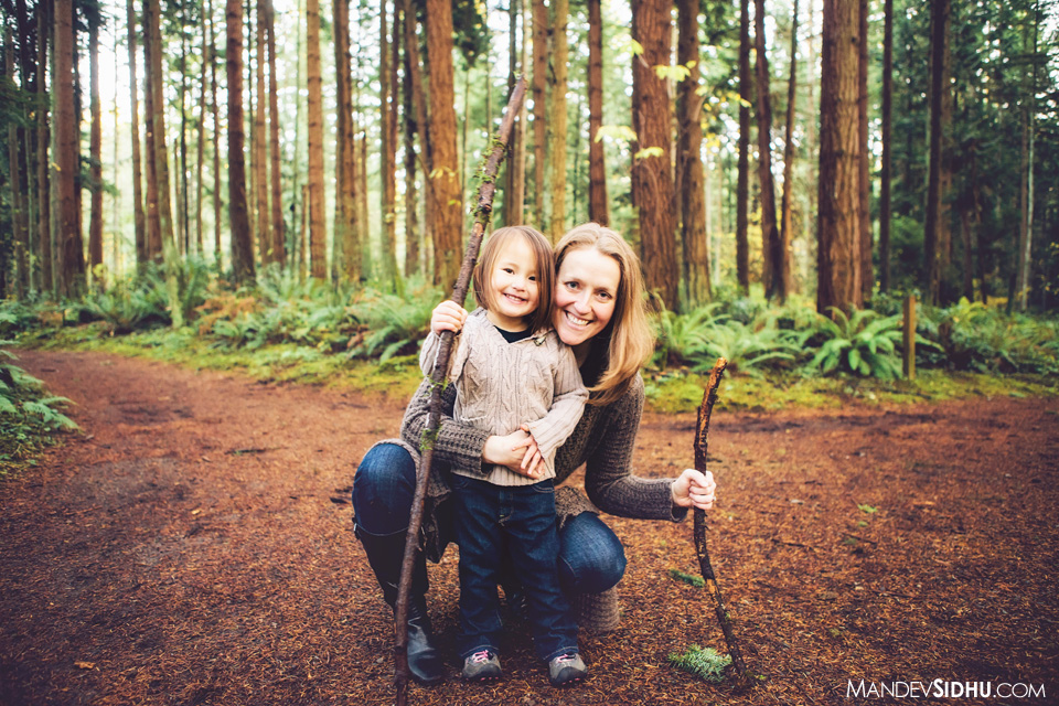 mother and daughter in trees during photo session