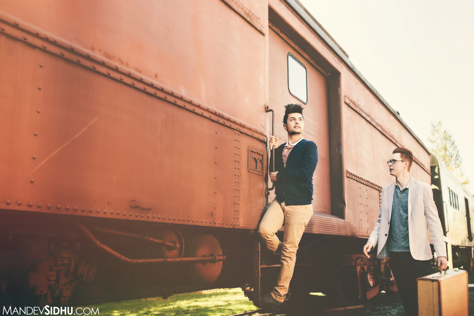 standing on a red train car