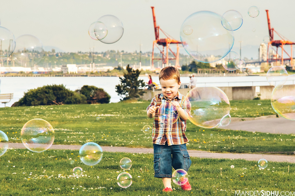 Henry playing with the large bubbles