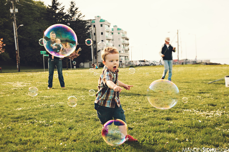 Chasing the huge bubbles trying to make them pop