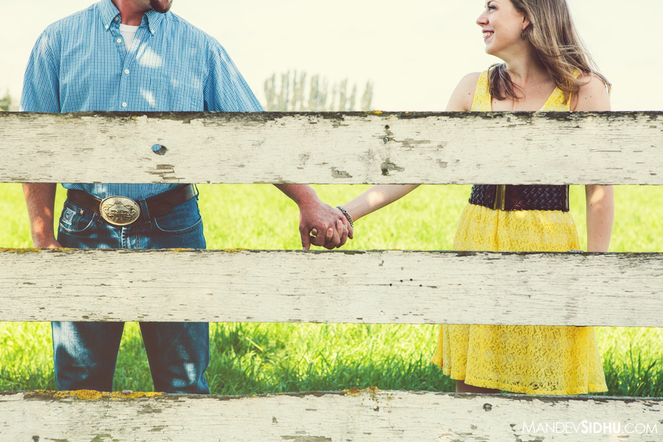 white fence country engagement photo holding hands in whatcom county