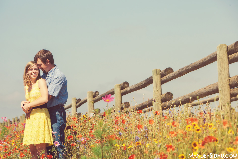 country engagement photograph with wildflowers