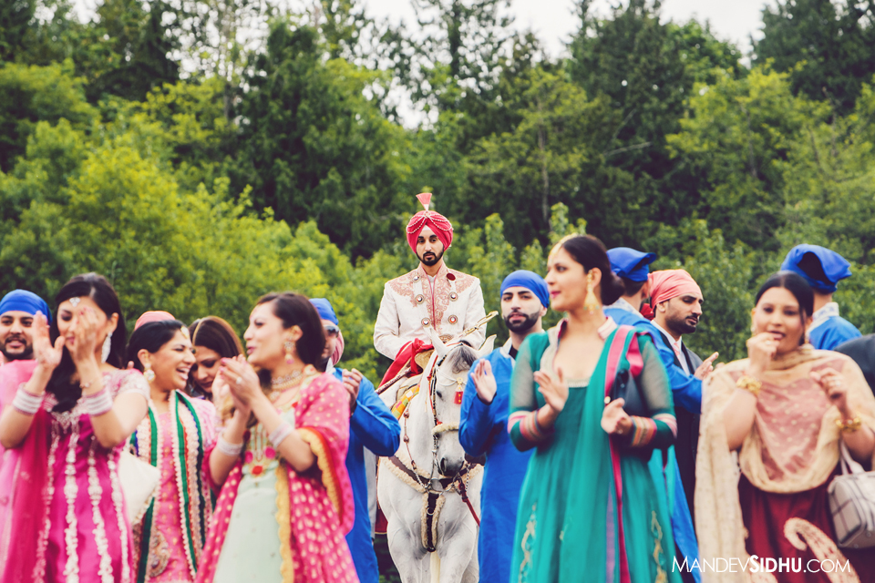 indian groom on horse for baraat