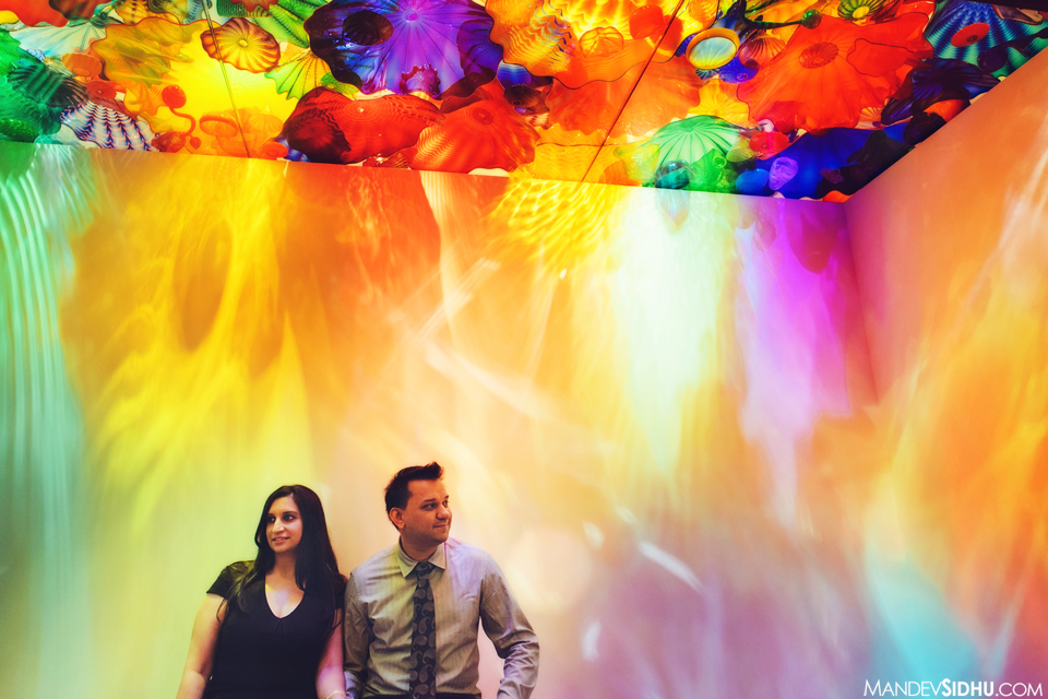 colorful photo of couple with beautiful Chihuly art