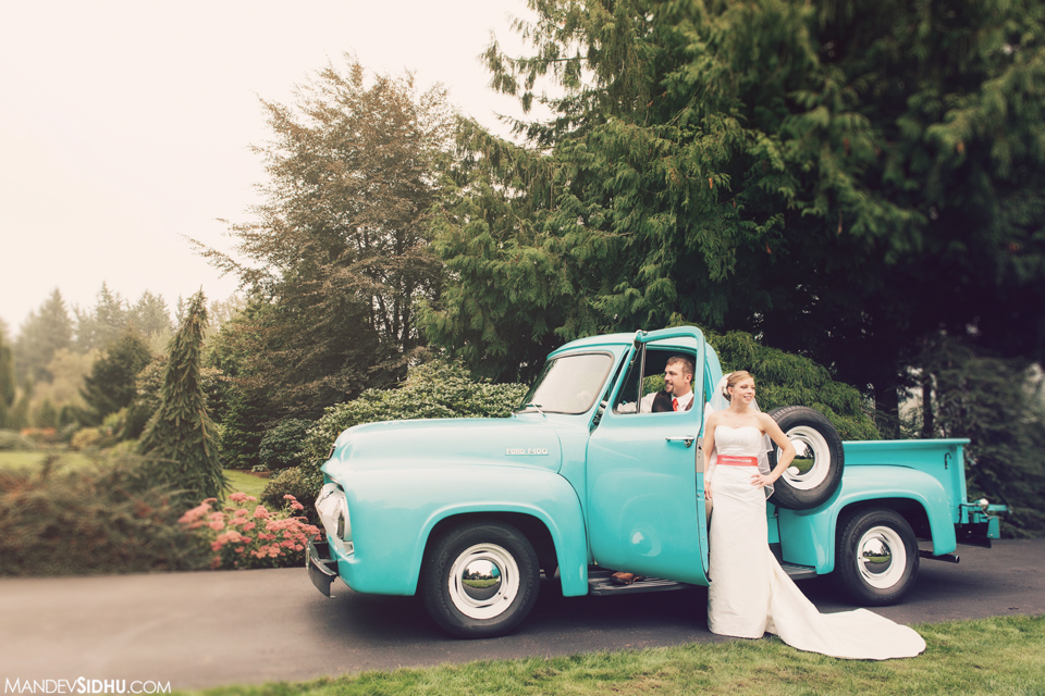 Country Wedding Photograph of Bride and Groom with vintage pickup truck