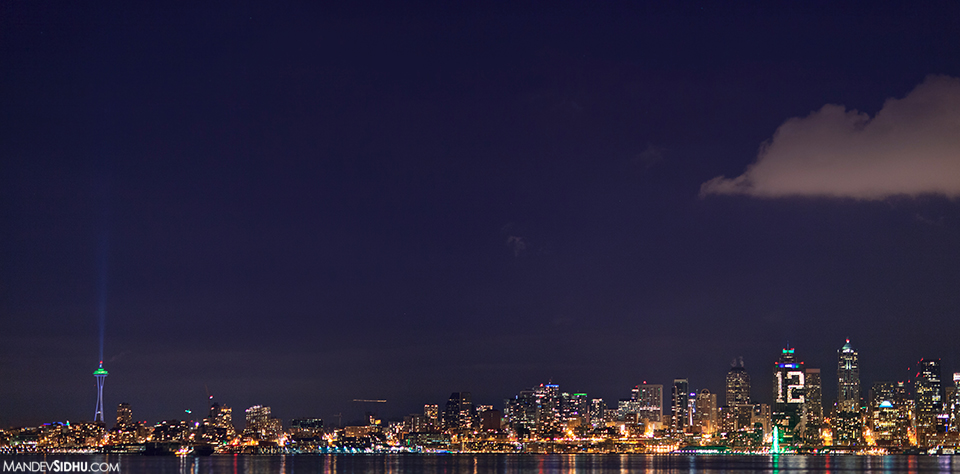 Seattle skyline at night time 12th man building for Seahawks