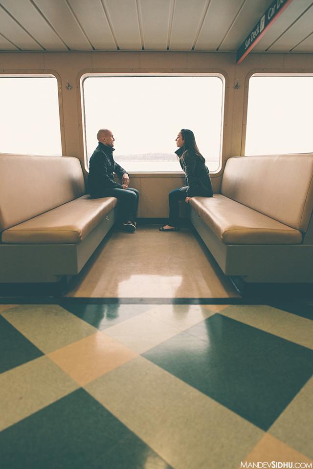 engagement couple sitting inside ferry