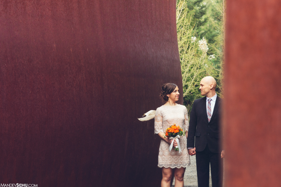 beautiful portrait of bride and groom at Seattle Sculpture Park in Seattle