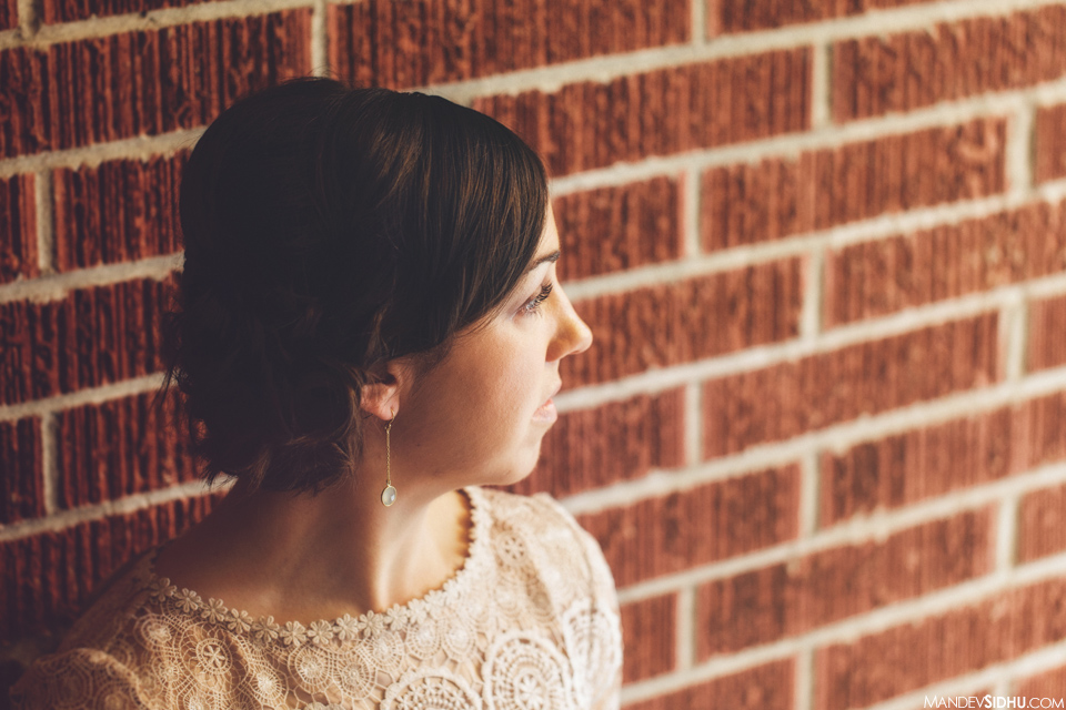Bride photo against brick wall