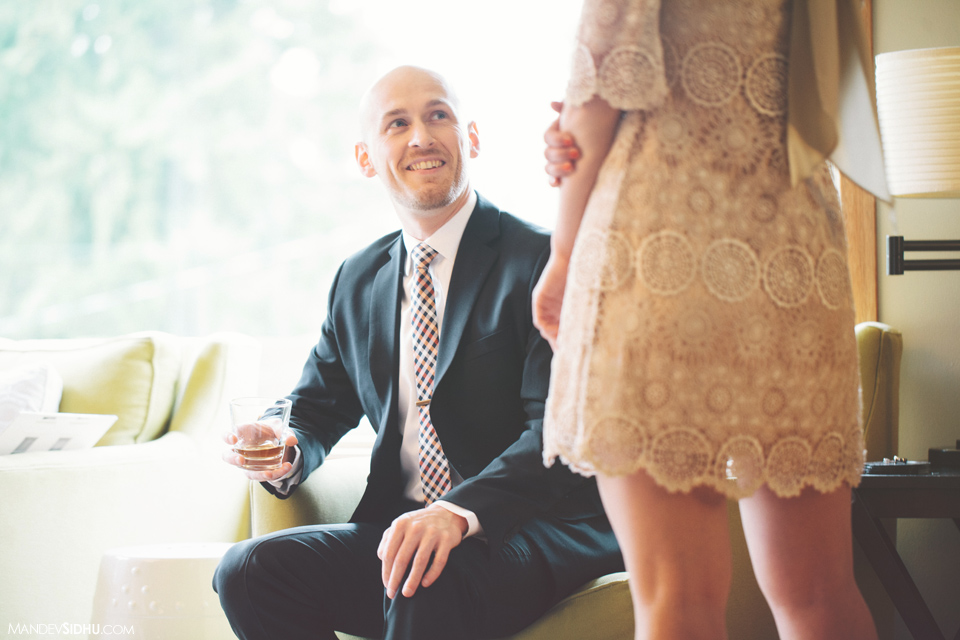 smiling happy groom seeing bride