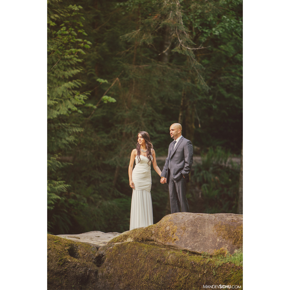 engagement photo on huge boulders in Pacific Northwest at Whatcom Falls Park