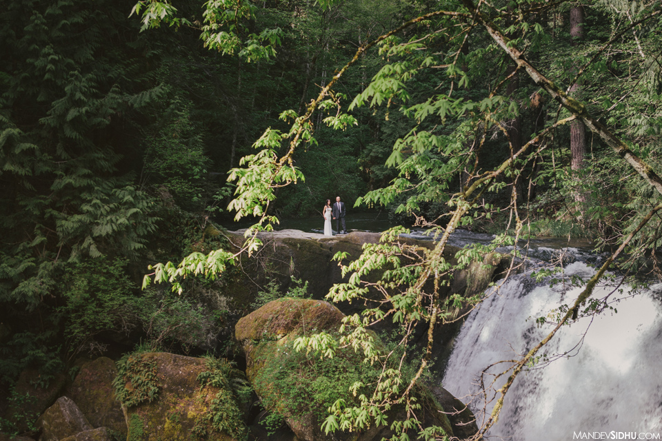 Engagement photo on rocks next to waterfall