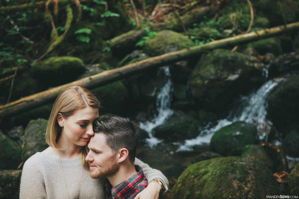 Candid natural engagement photo with waterfall