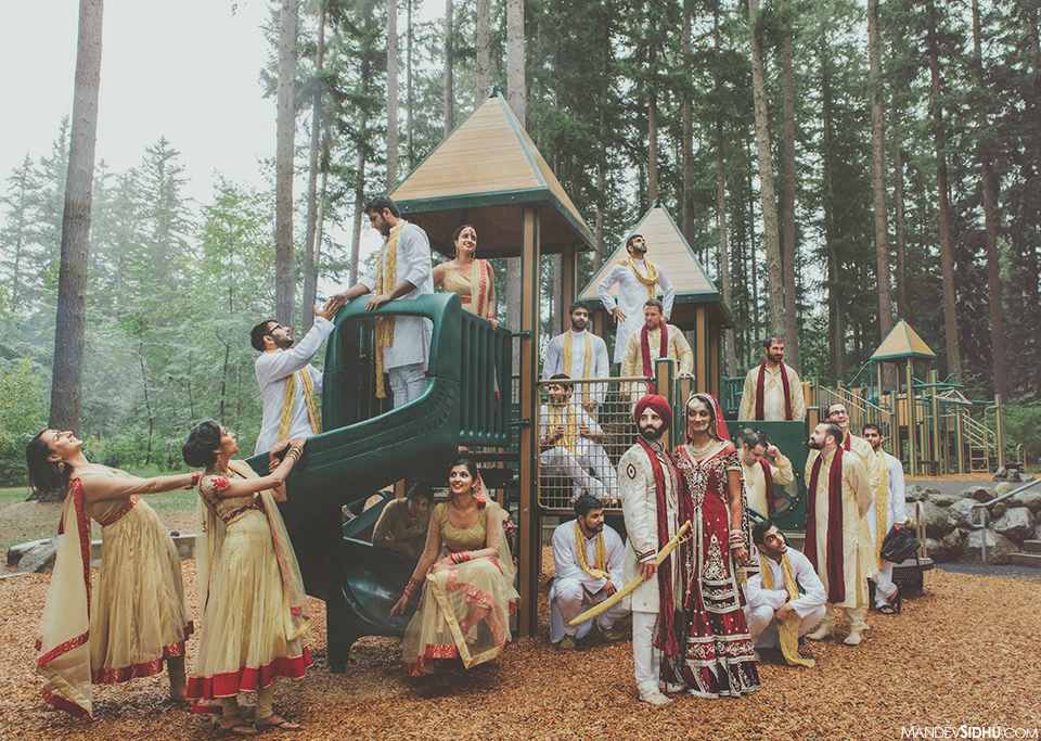 creative wedding bridal party pose on playground for group photo