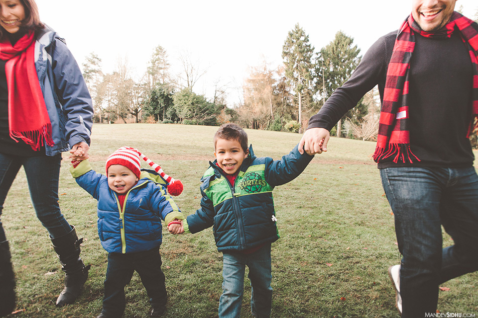 happy family holding hands at Woodland Park