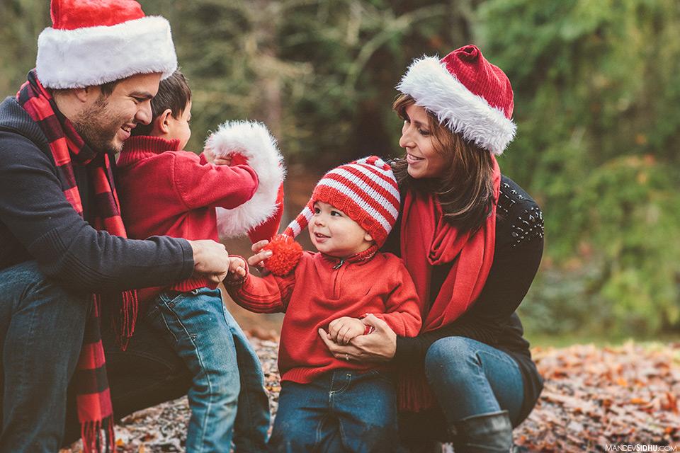 family photo wearing Christmas hats at Greenwood's Woodland Park