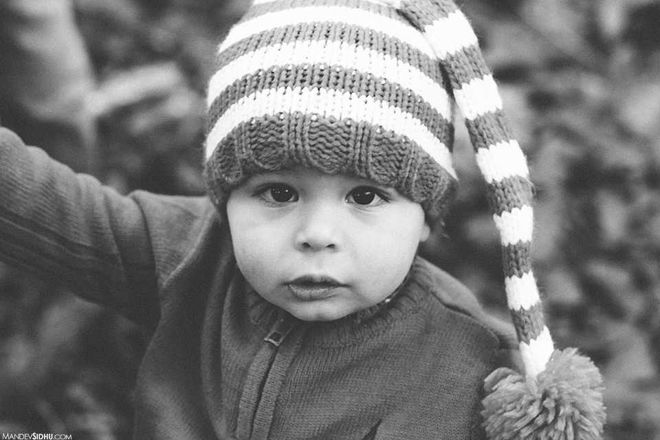 artistic, emotional, photojournalistic family photo of son at the park