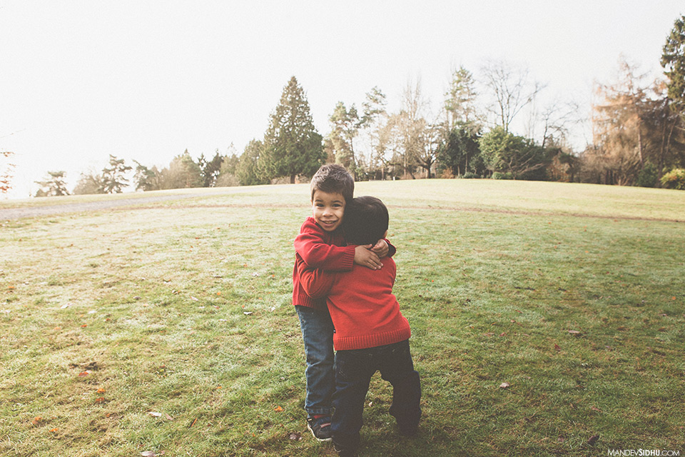 brothers hugging in the park
