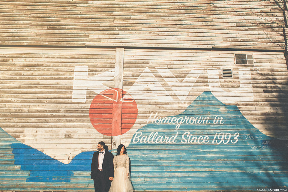 Awesome pic in front of Kavu wall in Ballard, wearing white dress and bow-tie suit