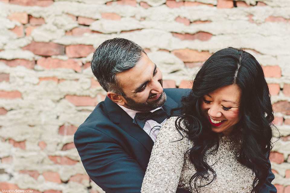 Engagement photos in front of a brick wall in Ballard, WA