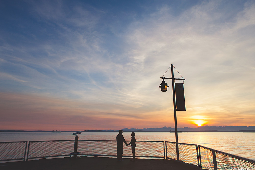 sunset engagement photo on the pier in downtown seattle