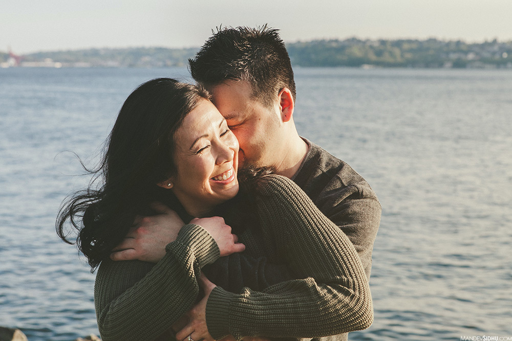 sunset engagement photos on the pier in downtown seattle