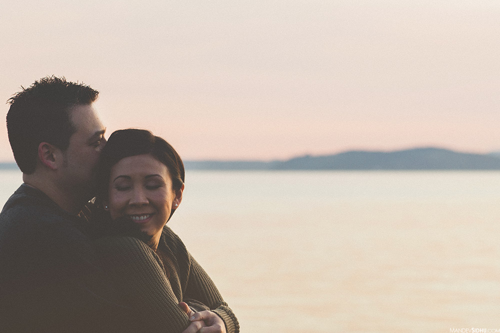 Sunset engagement photo on the seattle waterfront