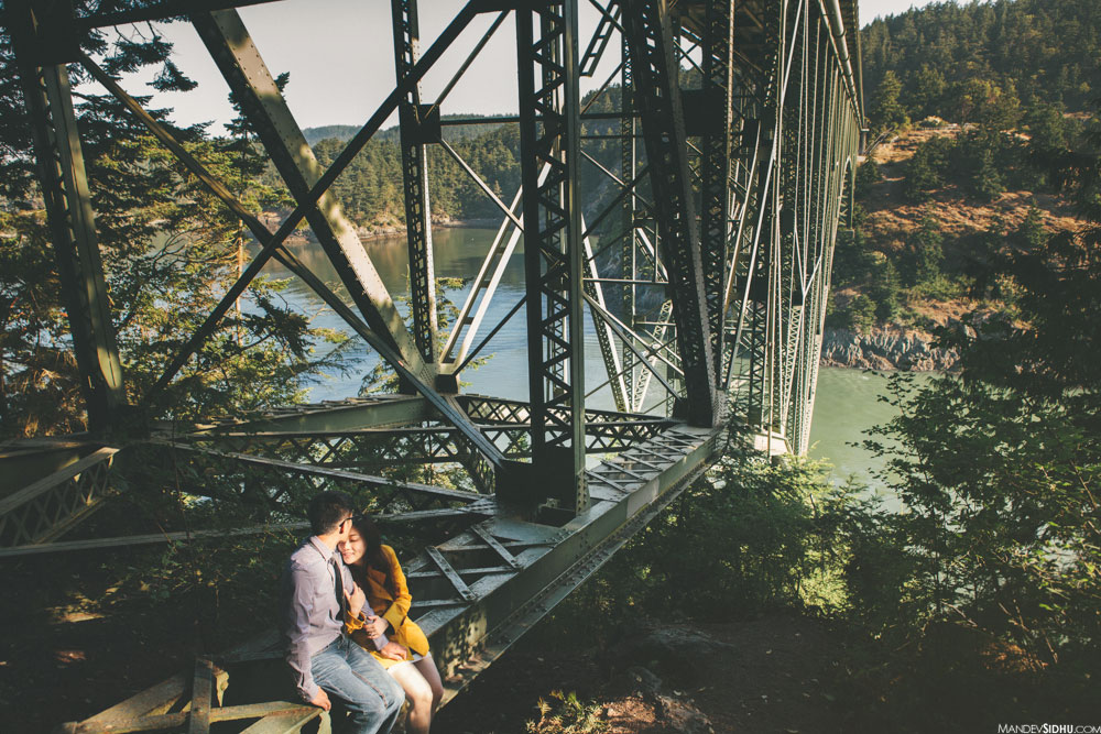deception pass engagement sitting on bridge