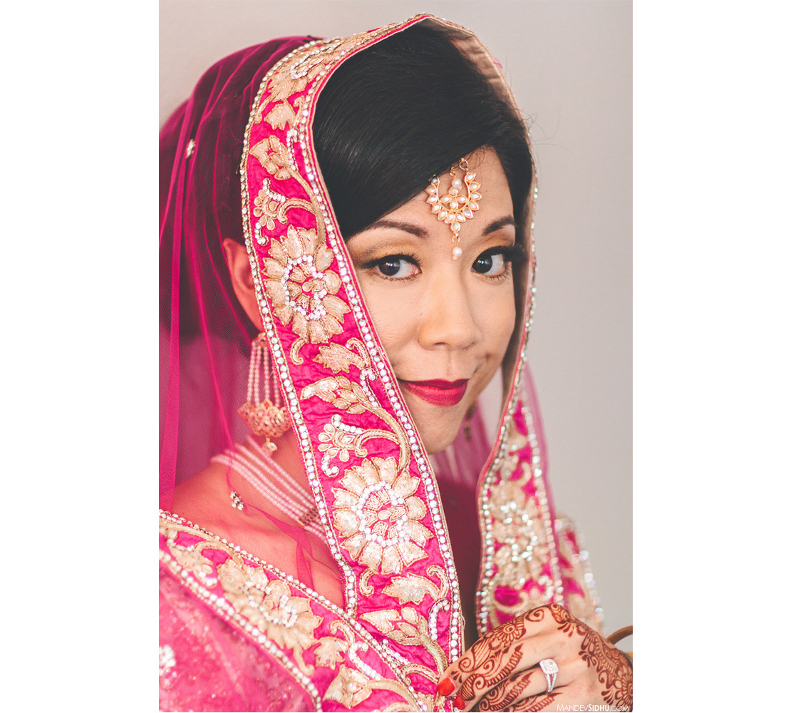 Indian-Asian bride wearing pink lehenga